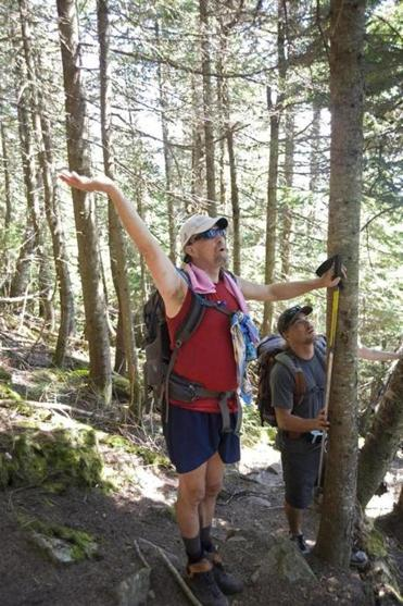 Randy Pierce held out a few raisins in the hopes of attracting a gray jay to his hand during a hike on Willey Range Trail.