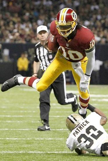 Robert Griffin III played with poise in his NFL debut, throwing for 320 yards and two TDs.