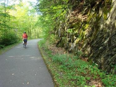 The 11.2-mile Ashuwillticook Rail Trail is a former railroad corridor converted into a 10-foot-wide recreation path that winds through Adams, Lanesborough, and Cheshire as it passes through the Hoosic River Valley.