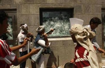 Yemeni protesters broke a window of the US Embassy during a protest about a film ridiculing Islam's Prophet Muhammad.