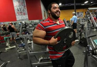 Moustafa Ismail is 5 feet 11 inches tall, 270 pounds, and says he has curled 400 pounds and bench-pressed 500.