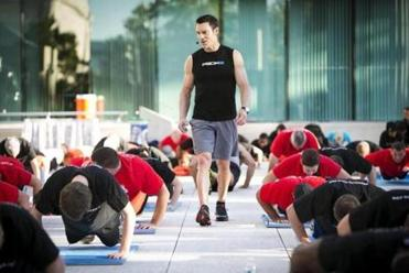 Fitness guru and P90X creator Tony Horton leads a fitness class in the courtyard of the Canadian Embassy.
