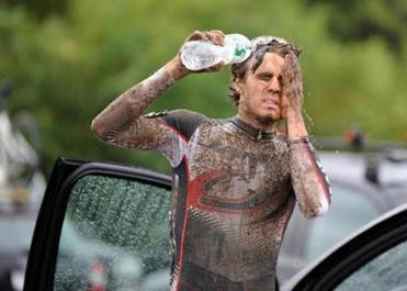 Jesse Anthony washed up in the parking lot after racing through the rain and mud in Gloucester.