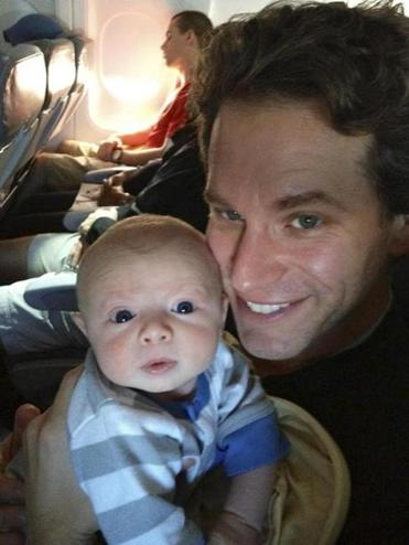 The author and his son, Wolf, just two weeks in this world, look keen for some adventuring at 35,000 feet above it all en route to a family reunion.