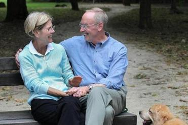 Cambridge, MA., 09/26/12, Elizabeth Warren and her husband Bruce Mann and their golden retriever Otis at the Fresh Pond Reservoir. Section: Metro Suzanne Kreiter/Globe staff