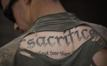 "US Army Sergeant James Wilkes displayed his tattoo, which reads: ""Sacrifice. Without fear there is no courage."""