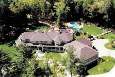 The Schillings bought the 20-room Medfield house from former New England Patriots quarterback Drew Bledsoe for $4.5 million in 2004. The property includes a batting cage.