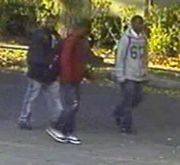 Police released an image taken from surveillance video of three men whom they suspect in the Oct. 5 robbery at Thatcher and St. Paul streets.