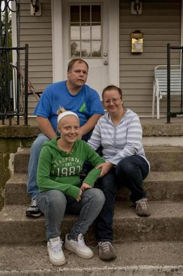 """I just don't think either one's going to do all that much,'' Neil Howell said of President Obama and Mitt Romney and rise in the nation's poverty rate. Howell lives with his wife, Debbie, and daughter, Amber, in Cincinnati."