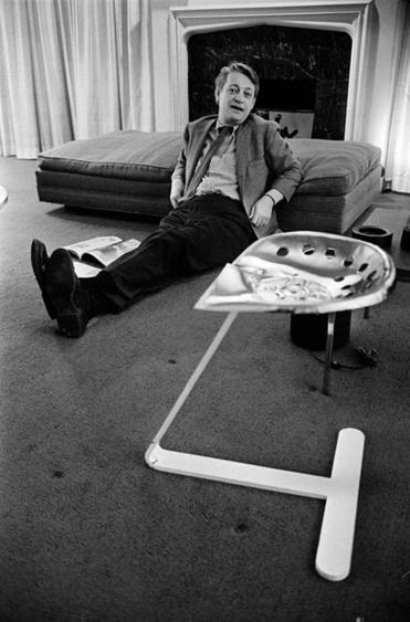 The architect at home in 1968 with a tractor-seat he made.