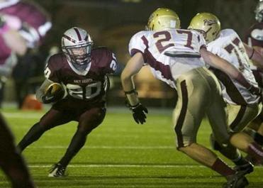 WESTFORD, MASSACHUSETTS -- 10/12/2012 -- Ben Rodman of Westwood runs with the ball in the first quarter of his team's game against Concord-Carlisle in Westford. Brian Feulner for the Boston Globe