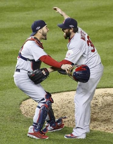 Jason Motte set down the Nationals in the ninth, then embraced Tony Cruz as the Cardinals advance to the NLCS.