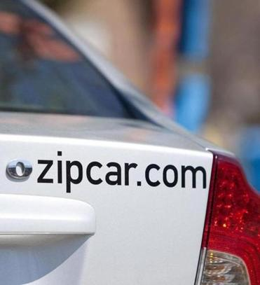 Zipcar benefited from continued expansion.