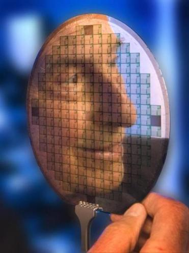 Stan Ovshinsky's face was reflected in one of his inventions, an Ovonic quantum control device.