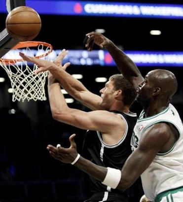 The Nets' Brook Lopez is denied an easy 2 points by Kevin Garnett during the first half of the Celtics' 115-85 win.