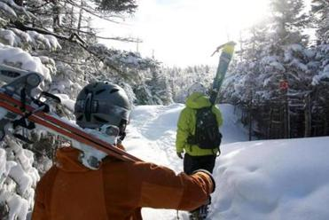 Skiers head to the backcountry at Sugarloaf in western Maine.