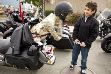 Victor Pelatere, 9, looked at a zombie ornament on the back of a motorcycle before the 24th annual Halloween Witch Ride from Everett to Shetland Park in Salem.
