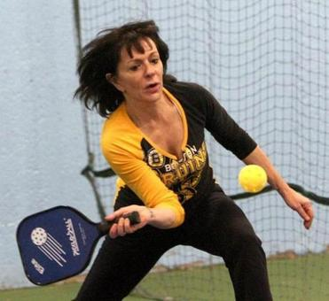 Susan Hiitt of Worcester played doubles Pickleball on a tennis court set up for the game at the Longfellow Club in Wayland.