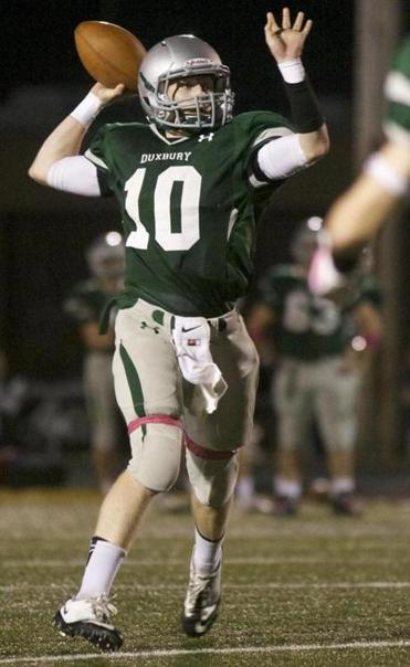 34 STRAIGHT WINS AND COUNTING — Sean McCarthy directed Duxbury to a 14-7 overtime victory over Hingham. Schools, C7-9.