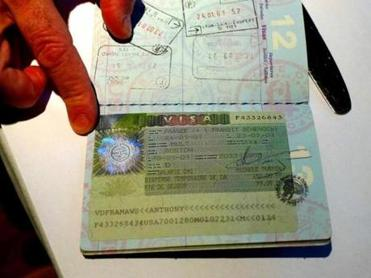 Chef Tony Maws with his passport open to the page of his French visa.