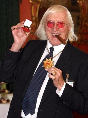 Sir Jimmy Savile, a fixture on British TV for decades who died at 84, is at the center of a sexual predator scandal involving the BBC.