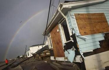 In the Queens borough of New York, a rainbow could be seen behind homes devastated by the storm.