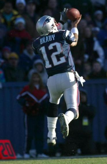 Tom Brady caught a 23-yard pass from Kevin Faulk.