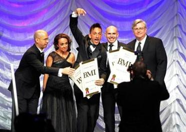 "Clinton Sparks (center) at the 19th Annual BMI Latin Music Awards in Las Vegas earlier this year, where he won an award. With Sparks (from left) are BMI executives Porfirio Pina and Delia Orjuela, fellow award winner Armando ""Pitbull"" Perez, and BMI's Phil Graham."