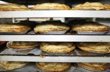Apple pies cooled on a rack at Mann Orchards in Methuen.