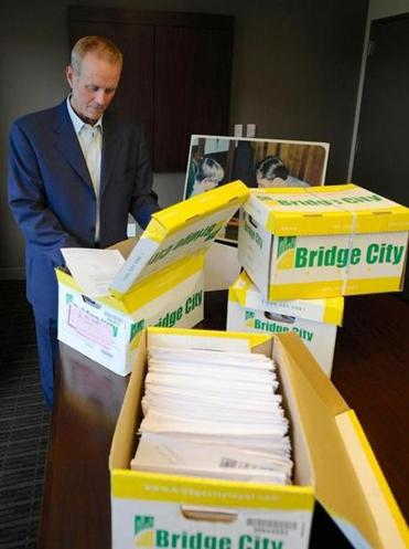 An Oregon attorney examines some of the 14,500 pages of previously confidential Boy Scouts documents.