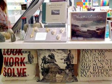 "Winslow Homer-themed merchandise in conjunction with the ""Weatherbeaten"" exhibition dominates the shop at the Portland Museum of Art."
