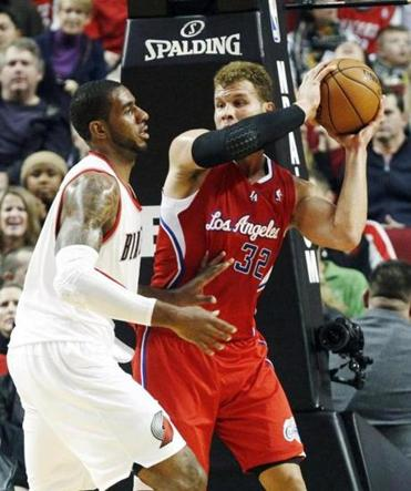Clippers forward Blake Griffin looked for an outlet pass against the Blazers' LaMarcus Aldridge Thursday night.