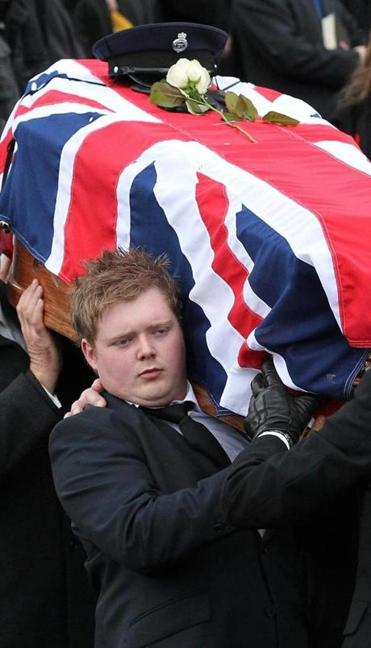 Kyle Black, son of David Black, carried his father's coffin during his funeral on Nov. 6.