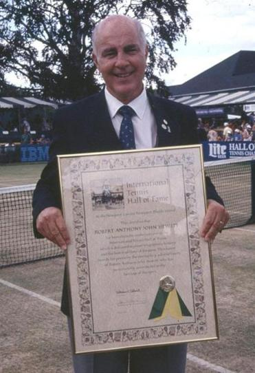Bob Hewitt holds a plaque from his induction into the International Tennis Hall of Fame in Newport in 1992.