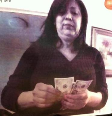 Authorities allege this image shows Adriana Ferreira as she was counting bribe money provided to her during an undercover investigation by federal and state officials.