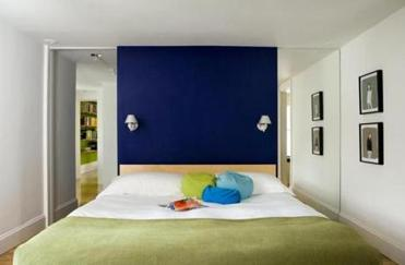 Placing a bed against an accent wall is pleasing to the eye.
