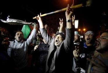 Palestinians in Gaza City celebrated what they called a victory over Israel on Wednesday.