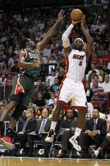 Miami's LeBron James shoots over Milwaukee's Ekpe Udoh in the first half. The Heat had to rally in overtime to beat the Bucks.