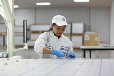 A worker at Wanxiang's solar panel manufacturing plant in Rockford, Ill.