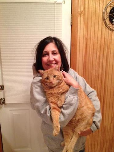 Humane society volunteer Susan Mariano with a rescue cat, Buddy.