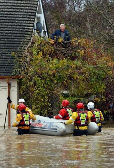 Crews evacuated residents from flood waters in St. Asaph, Wales, this week. Hundreds of people fled their homes.