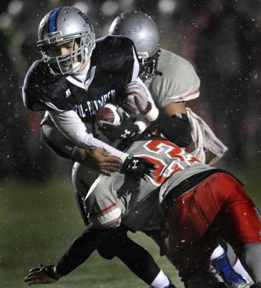 Bristol-Plymouth running back Adam Mota can't shake a pair of Madison Park defenders.