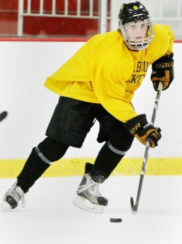 Weston 19-year-old Kyle Nickerson carries the puck during a recent Junior Bruins practice in Marlborough.