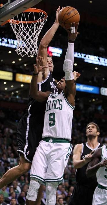 This was hand-to-hand combat between the Nets' Kris Humphries and Rajon Rondo (9); later they went toe to toe.