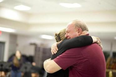 Percussionist Laurel Hentschel of Sharon (on left) got a hug from conductor Steve Bell of Middleborough.
