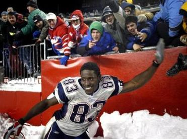 Deion Branch celebrated with fans after the victory.