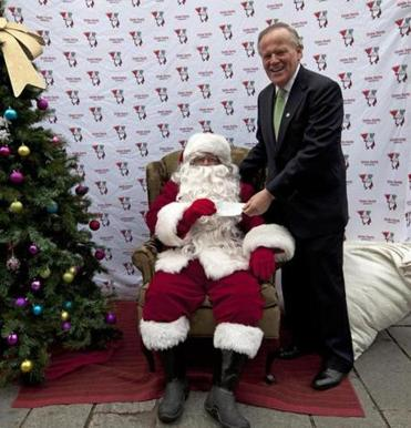 James Brett, president of The New England Council, presented Globe Santa with a donation.