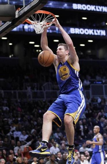 David Lee dunks for 2 of his 30 points as Golden State delivered a victory for coach Mark Jackson in Brooklyn.