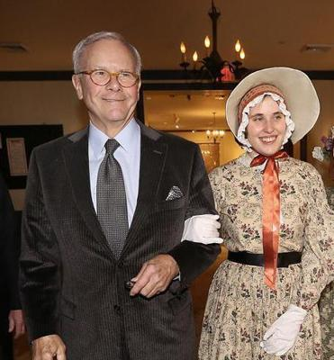 BACK HERE: Journalist and author Tom Brokaw is escorted by Victoria Belisle of Old Sturbridge Village for a dinner in his honor in Sturbridge on November 27.