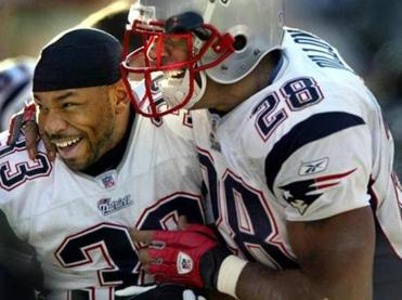Corey Dillon (right) was all smiles as he congratulated Kevin Faulk on his third-quarter touchdown.